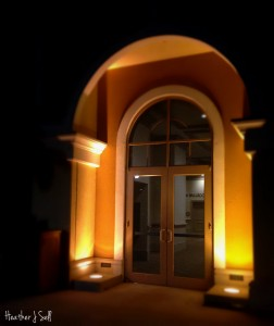 Photo of a night-lit glowing archway at Rosen Shingle Creek